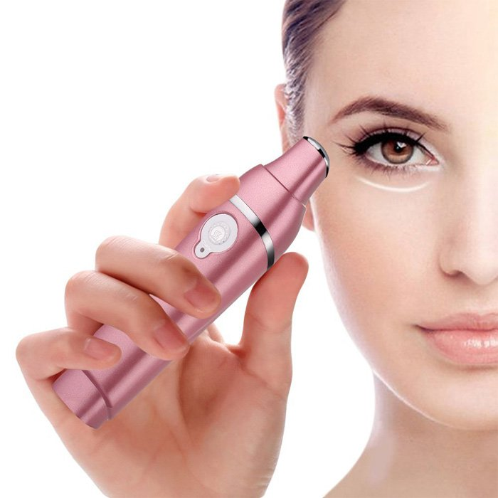 Beautiful Girl Use Rose Gold Sonic Care Eye Massager